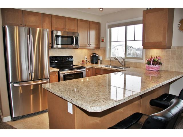 Main Photo: 1211 92 CRYSTAL SHORES Road: Okotoks Condo for sale : MLS(r) # C4111842