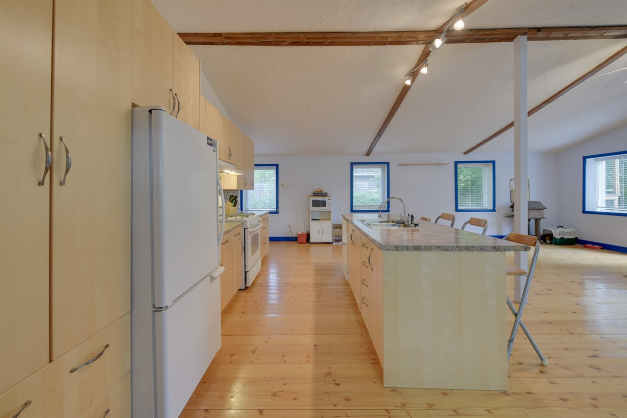 The kitchen is well laid out with loads of maple and a large fridge.