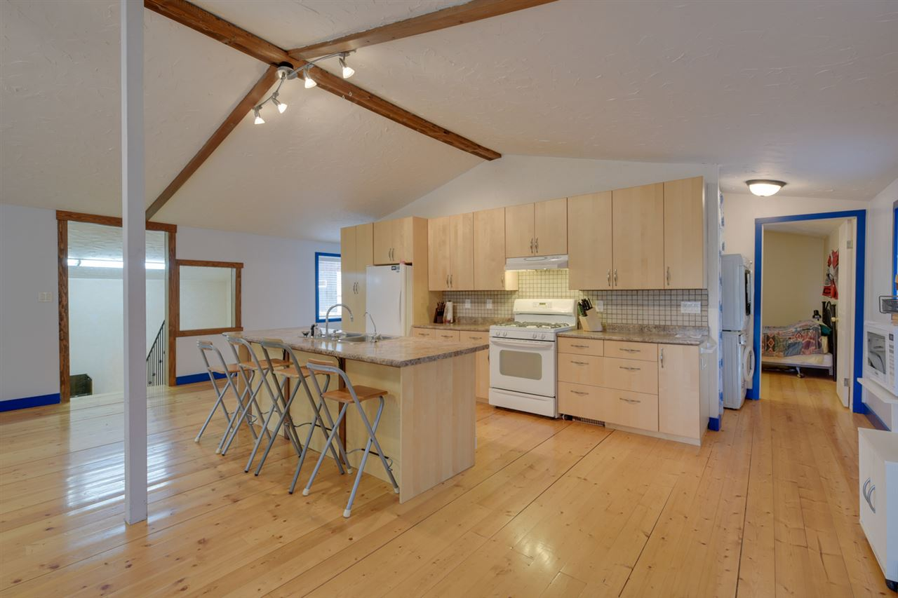 The kitchen is well laid out with loads of maple cabinets and a nice stove perfect for the chef at home.