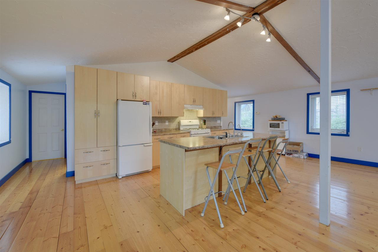 The kitchen is well laid out with loads of maple cabinets, a huge center island.