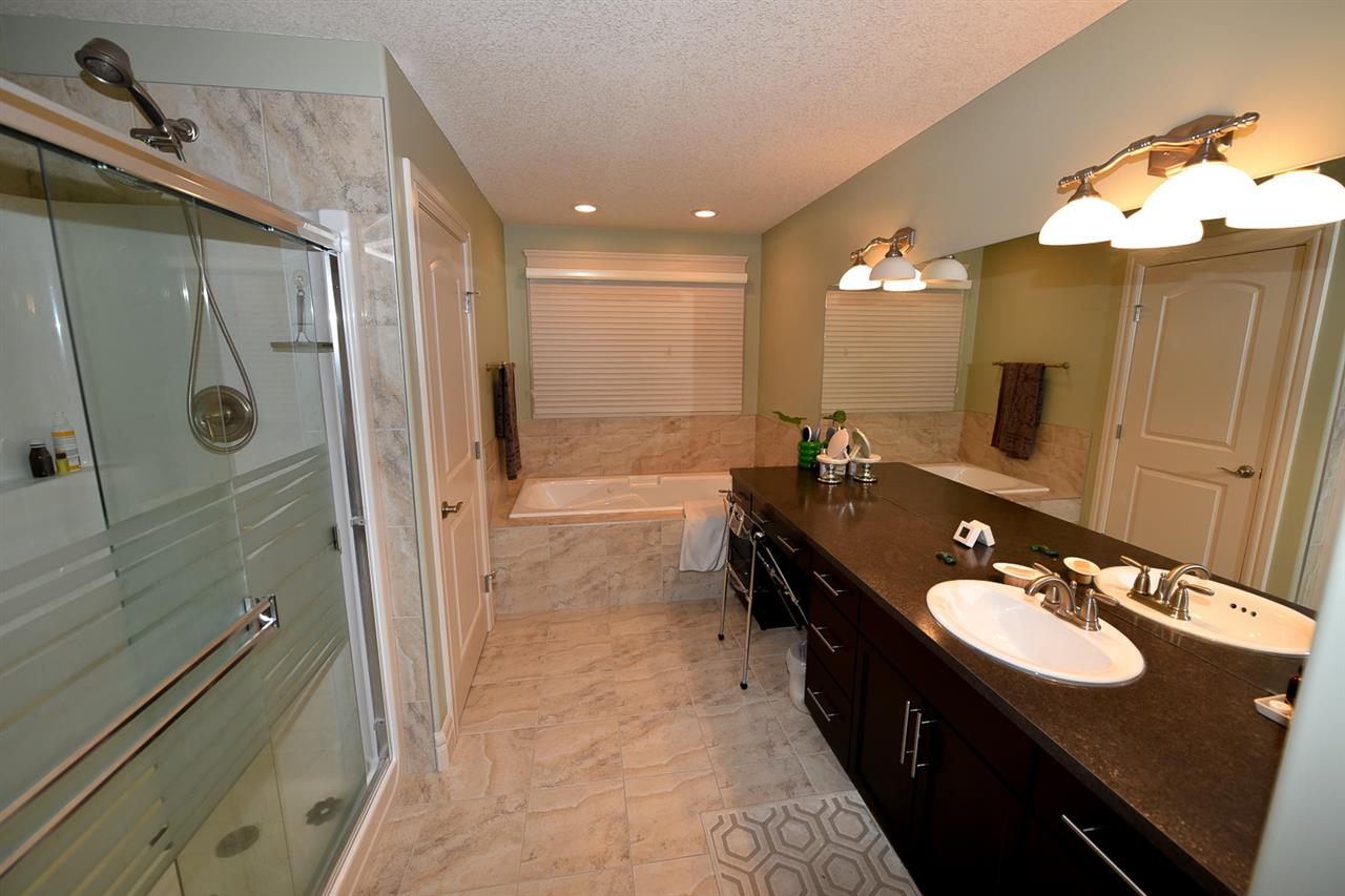 Look at the lap of luxury: a stand-up shower and a jetted tub.  Lots of space an a private water closet too.