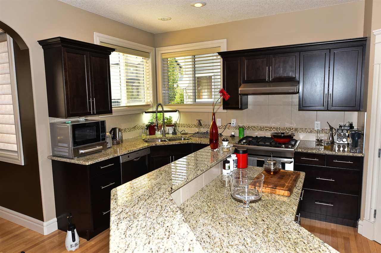 Note the granite countertops, the corner sink with double windows and the corner pantry.