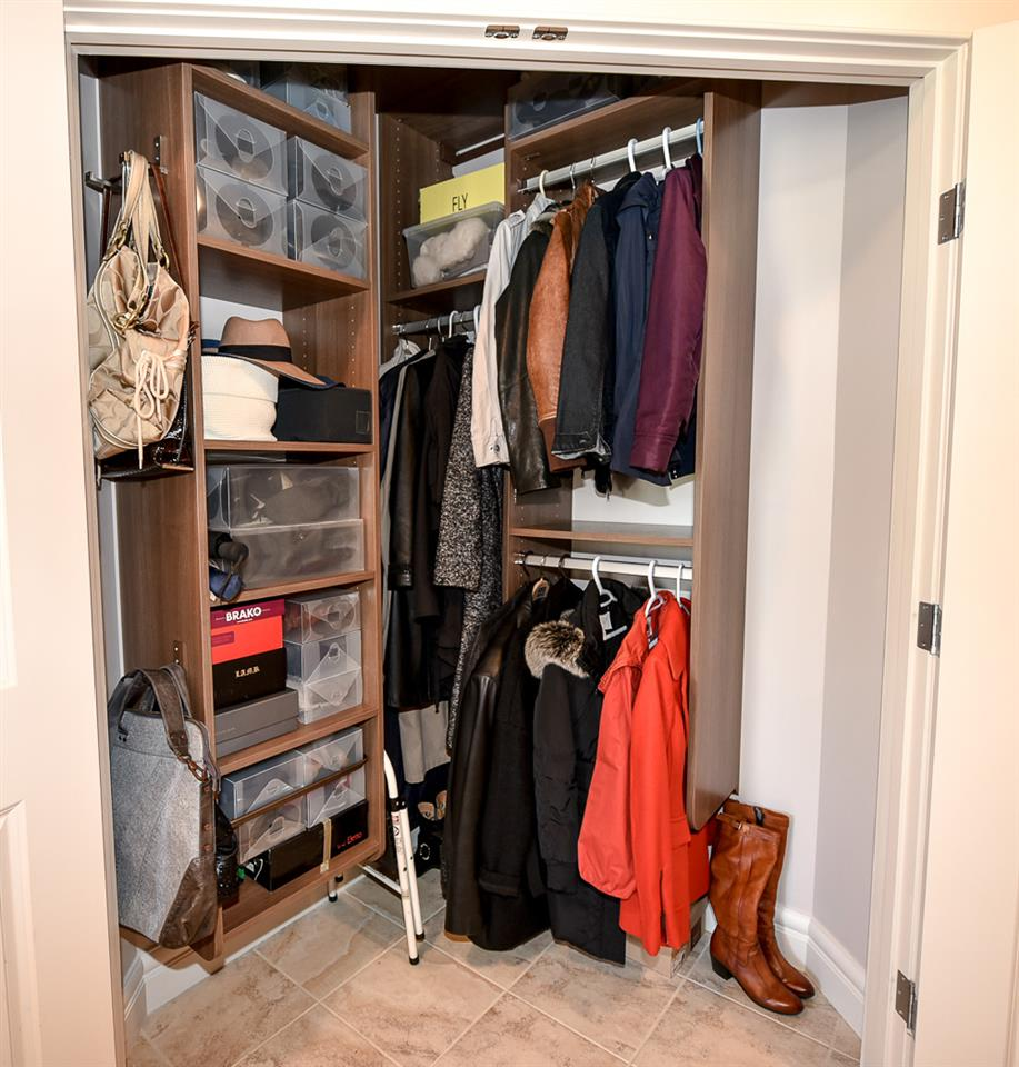 An impressive front closet by California Closets