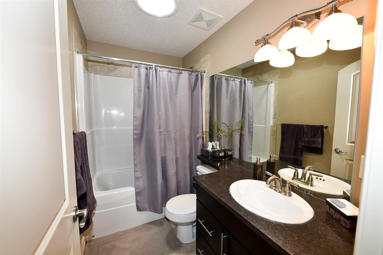 In showhome condition, this main upstairs bathroom is attractive and functional.