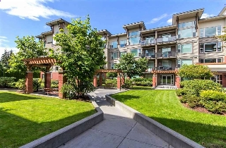 "Main Photo: 220 33539 HOLLAND Avenue in Abbotsford: Central Abbotsford Condo for sale in ""THE CROSSING - LUXURY APARTMENT"" : MLS® # R2196035"