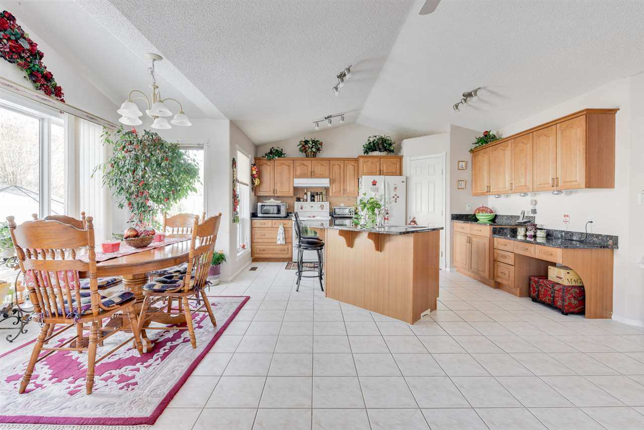 Kitchen features oak cabinets, granite counters and telephone desk