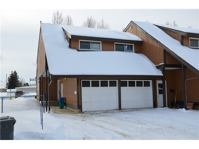 "Main Photo: 10604 102ND Street in Fort St. John: Fort St. John - City NW Townhouse for sale in ""CEDAR VILLAGE"" (Fort St. John (Zone 60))  : MLS®# N233815"