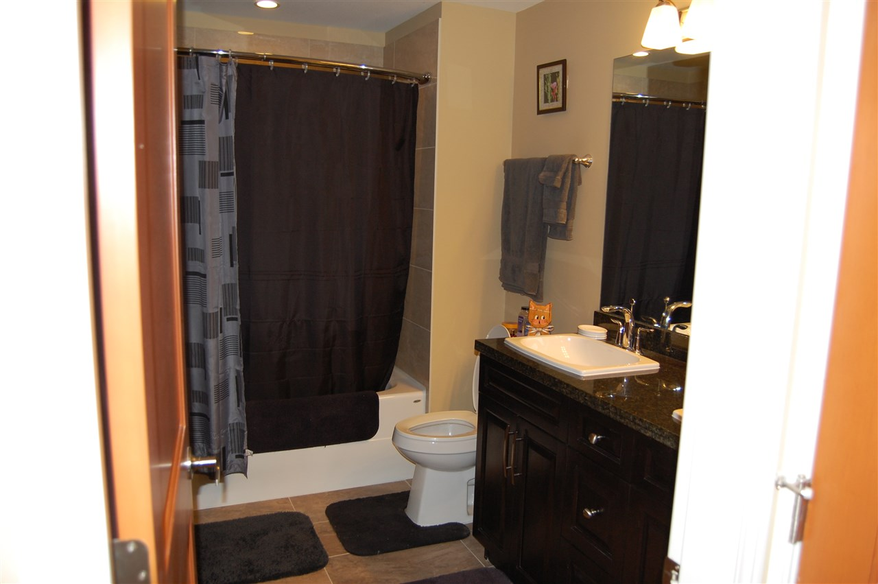 Heated Floors to keep your feet warm and fog free mirror in this bathroom to help you get the day started.