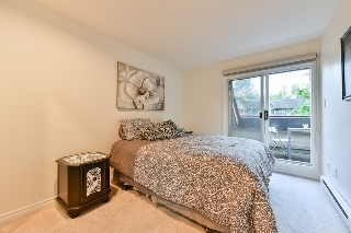 The 2nd bedroom has a large closet and access to the deck that is shared with the master bedroom.