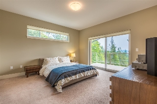 Spacious Master suite with gorgeous views of the Ocean and direct access out to the covered deck