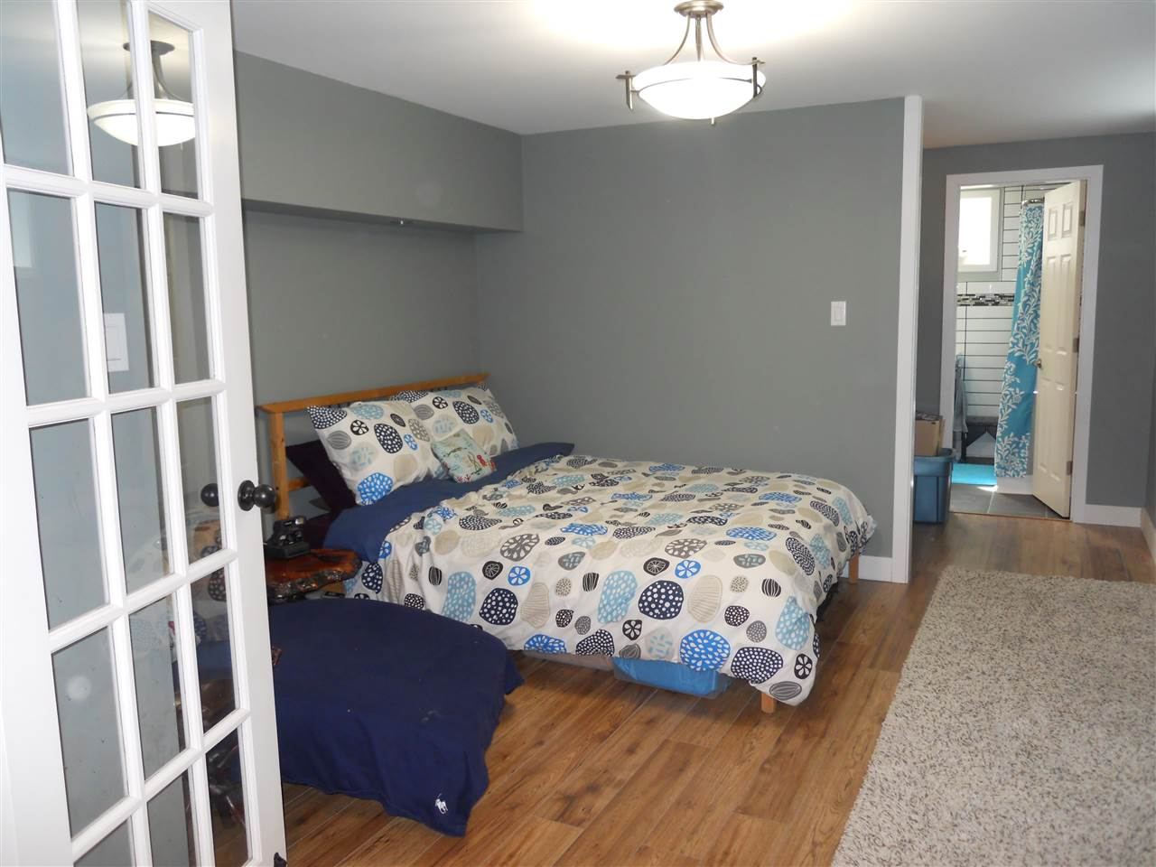 One of the two bedrooms downstairs