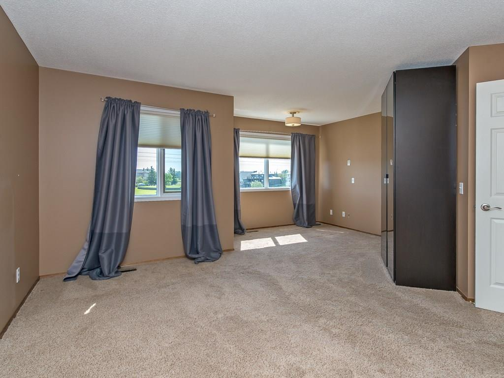 Photo 36: 167 LAKESIDE GREENS Court: Chestermere House for sale : MLS® # C4120469