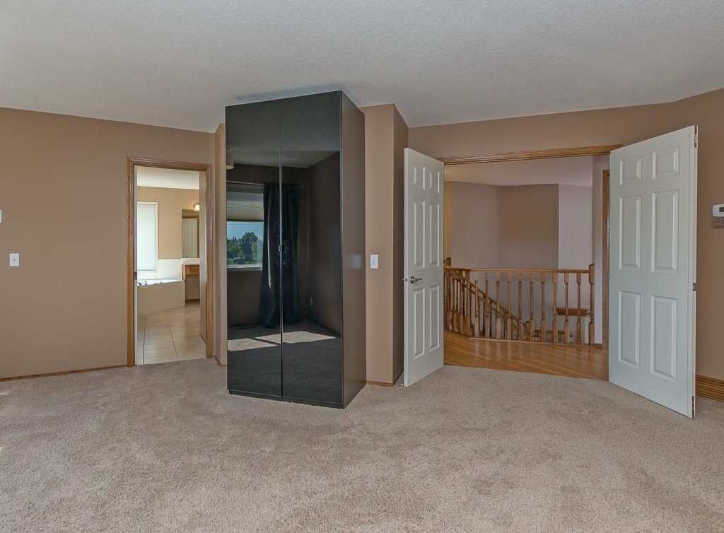 Photo 37: 167 LAKESIDE GREENS Court: Chestermere House for sale : MLS® # C4120469