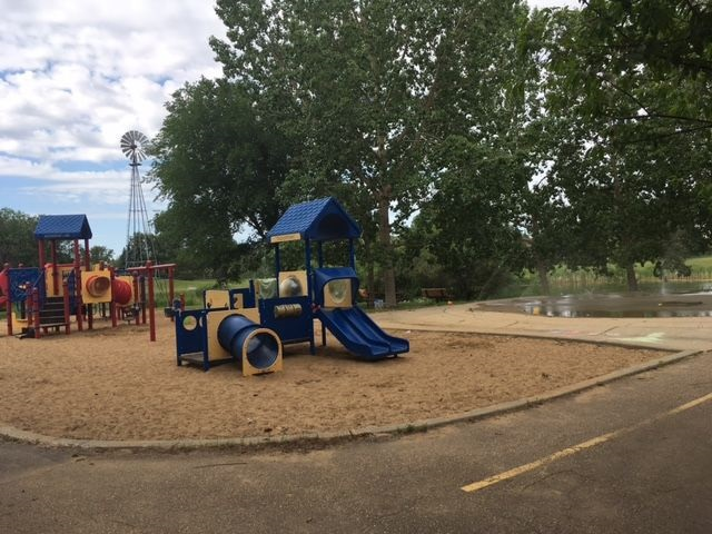 Spend your summers at the nearby playground & splash park only a block away