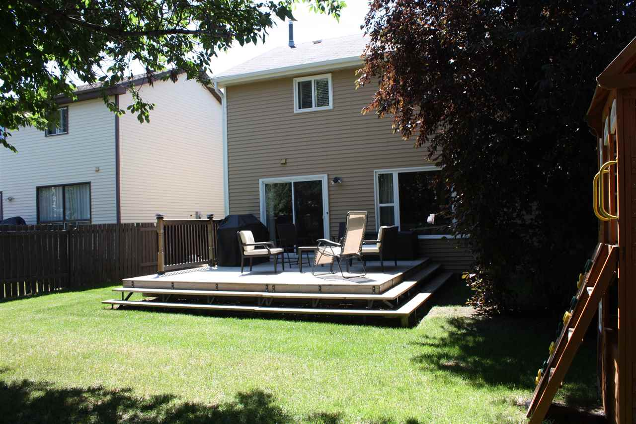 Relax & play in this nicely treed yard in a quiet family friendly neighbourhood