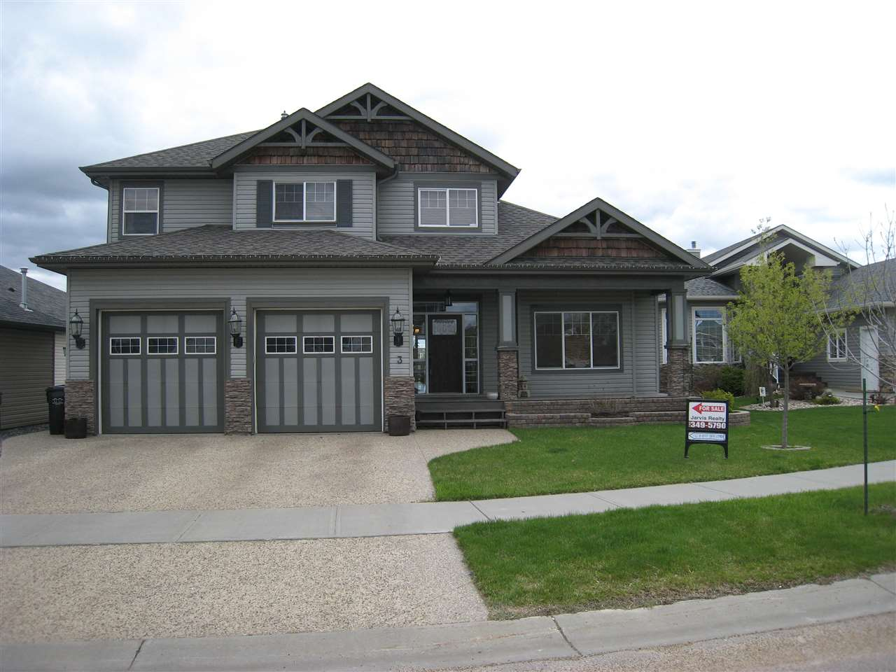 Wonderful curb appeal with this custom built home. Aggregate driveway, 2 overhead garage doors, beautiful covered front porch to sit and watch passersby and family friendly neighbourhood.