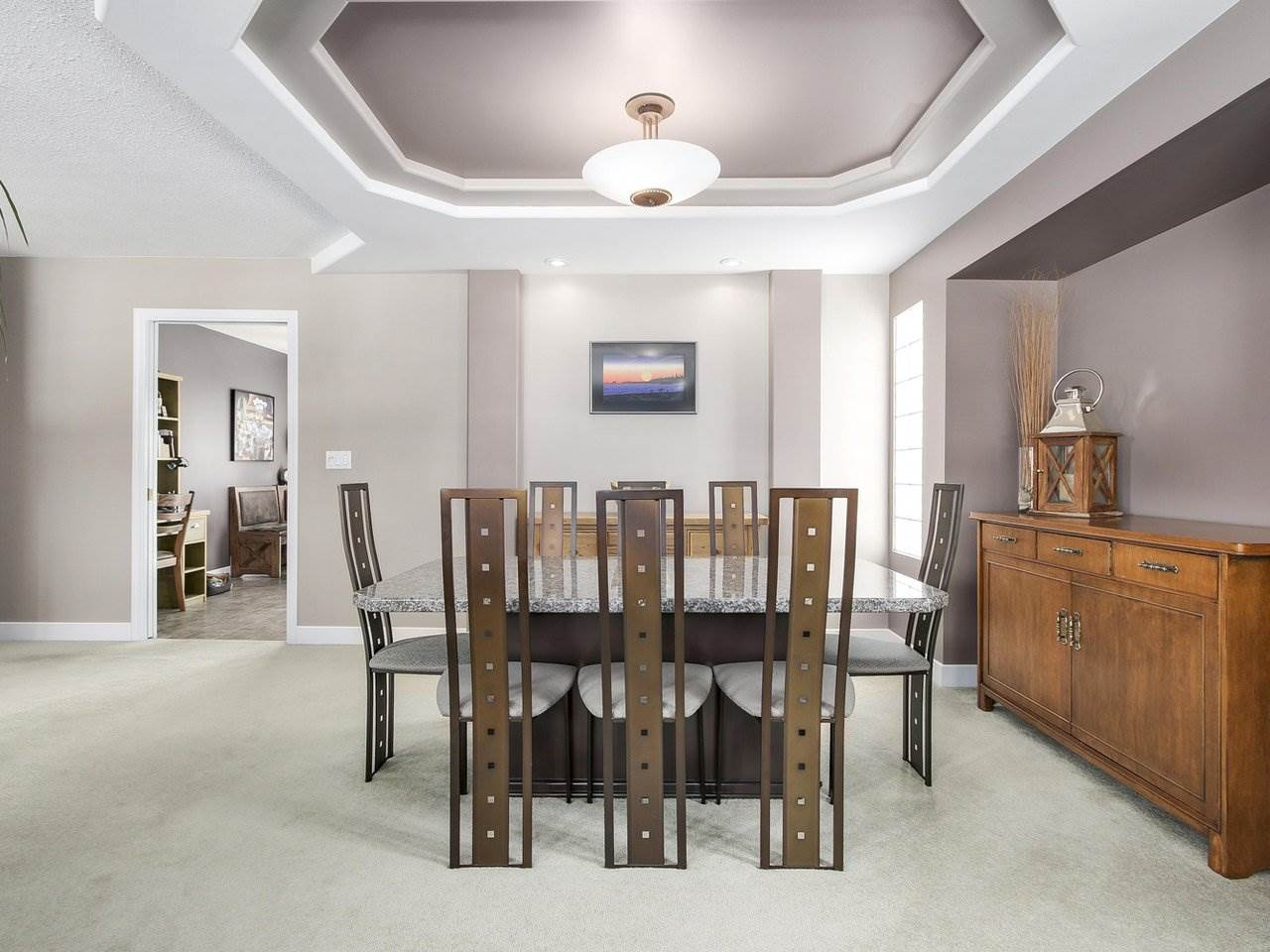 Nice ceiling detailing separates dining room and living room