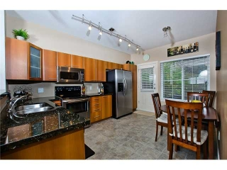 "Main Photo: 117 2000 PANORAMA Drive in Port Moody: Heritage Woods PM Townhouse for sale in ""MOUNTAIN EDGE"" : MLS®# V977096"