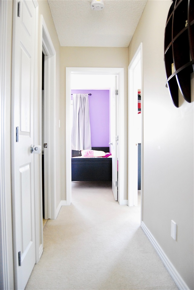 Your upstairs hallway leading to 2 bedrooms, 1 bath, and the master suite