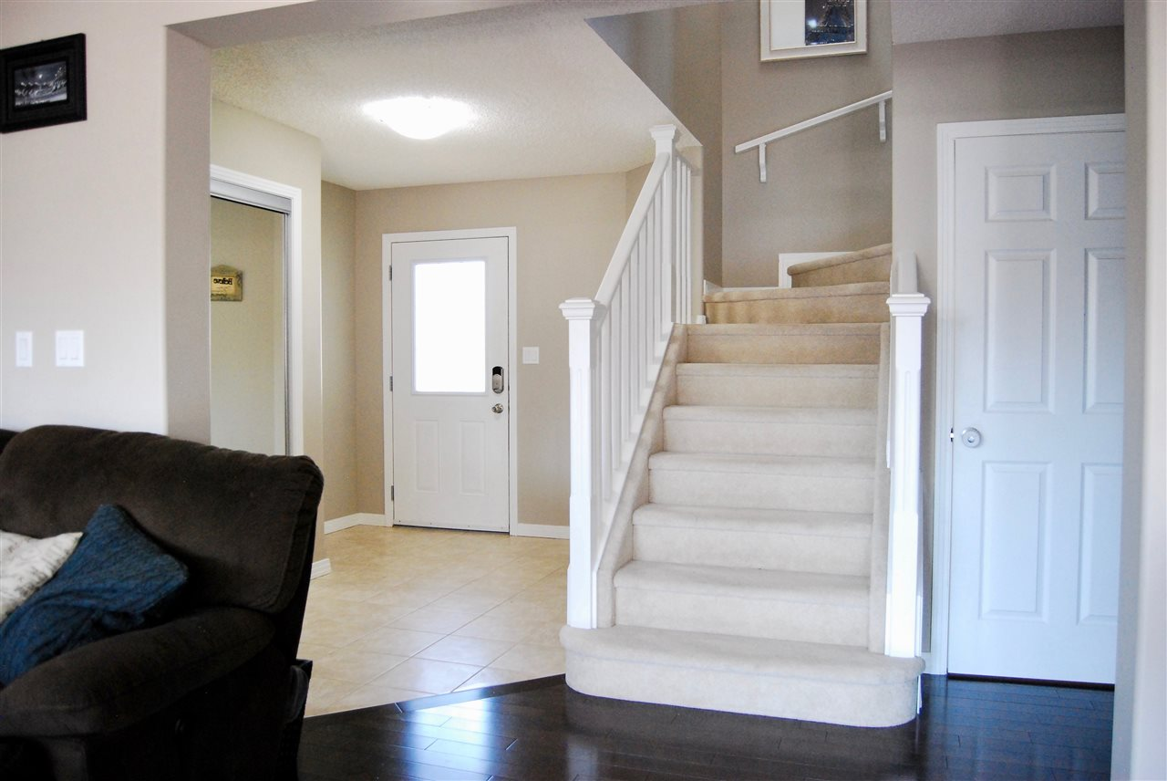 Plenty of room in this spacious front entryway next to the stairs leading to the huge bonus room and 3 bedrooms