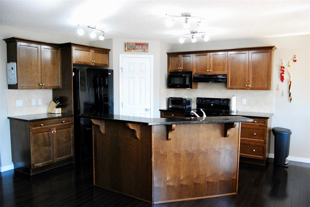 Granite countertops and plenty of cabinet space make this a perfect kitchen for cooking family meals in