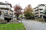 "Main Photo: 121 2551 PARKVIEW Lane in Port Coquitlam: Central Pt Coquitlam Condo for sale in ""THE CRESCENT"" : MLS®# R2009462"
