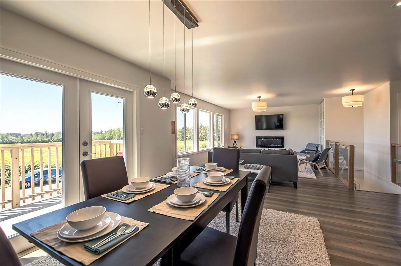 Dining Room with Double French Doors onto your balcony overlooking the green fields.