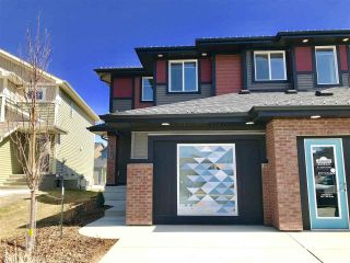 Main Photo: 8813 221 Street in Edmonton: Zone 58 House Half Duplex for sale : MLS®# E4106865