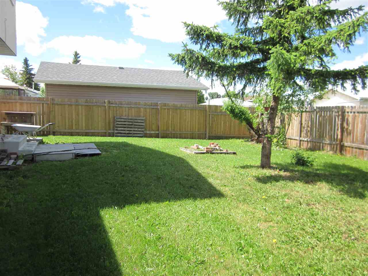 Large fenced and landscaped backyard.
