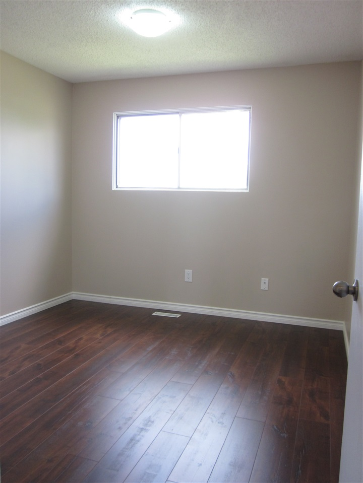 Good size bedroom with laminate flooring.