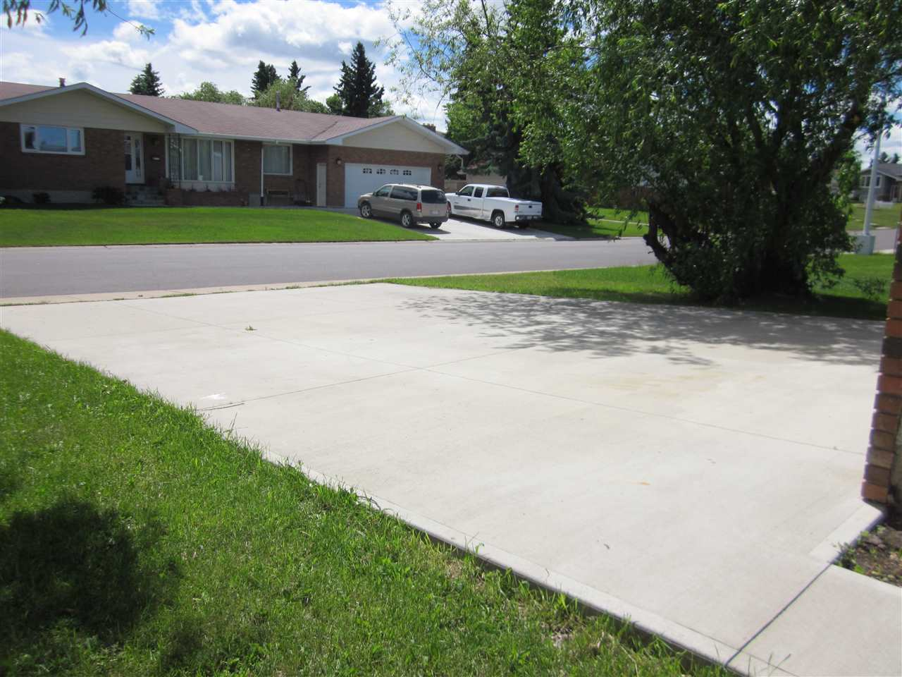 Newer driveway approximately 8 to 10 years old.