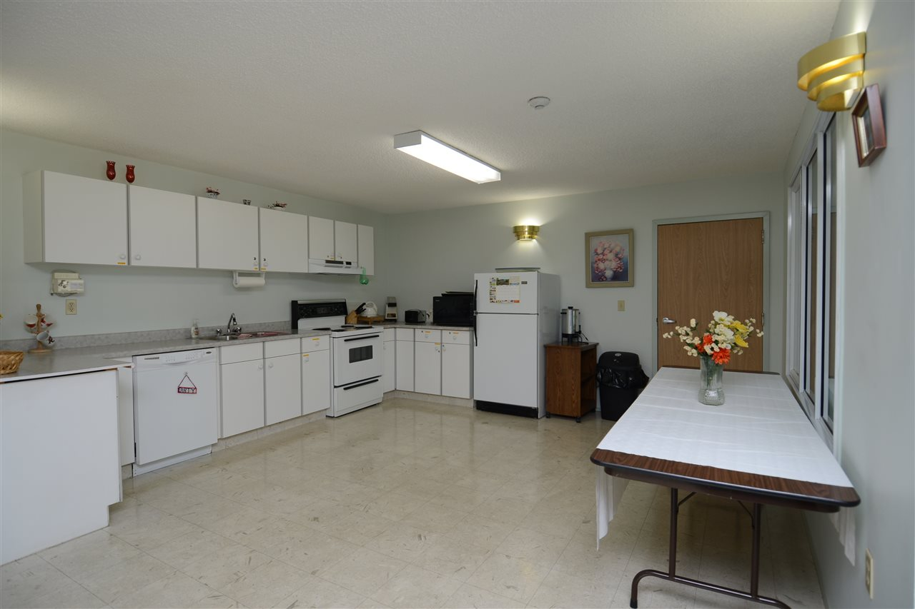 The main floor amenity room has a full kitchen for when you are entertaining family and friends