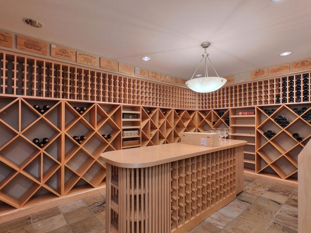 Expansive wine room for the wine connoisseur.