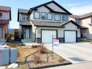 Main Photo: 15158 33 Street in Edmonton: Zone 35 House Half Duplex for sale : MLS(r) # E4059739