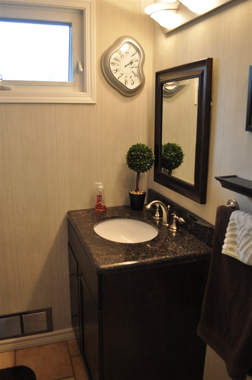 The main floor bathroom is a renovated 4 piece, with ceramic tile, new vanity, & warm finishes.  There is an additional bathroom on the lower level will impress, with a glass shower, oversized vanity, additional storage cabinetry, & loads of floor space