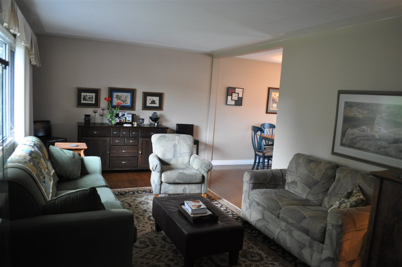 The living room is bright, open and welcoming.  Great flooring throughout