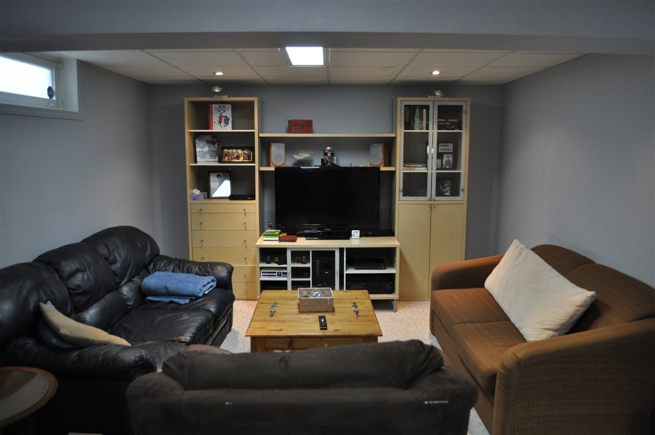 Converted from bedroom use, this area of the basement is currently set up as a casual theater area for the family, & is open to the rest of the finished rec room & bar.  Easily convert it to your use, or partition it off, to return it to bedroom service