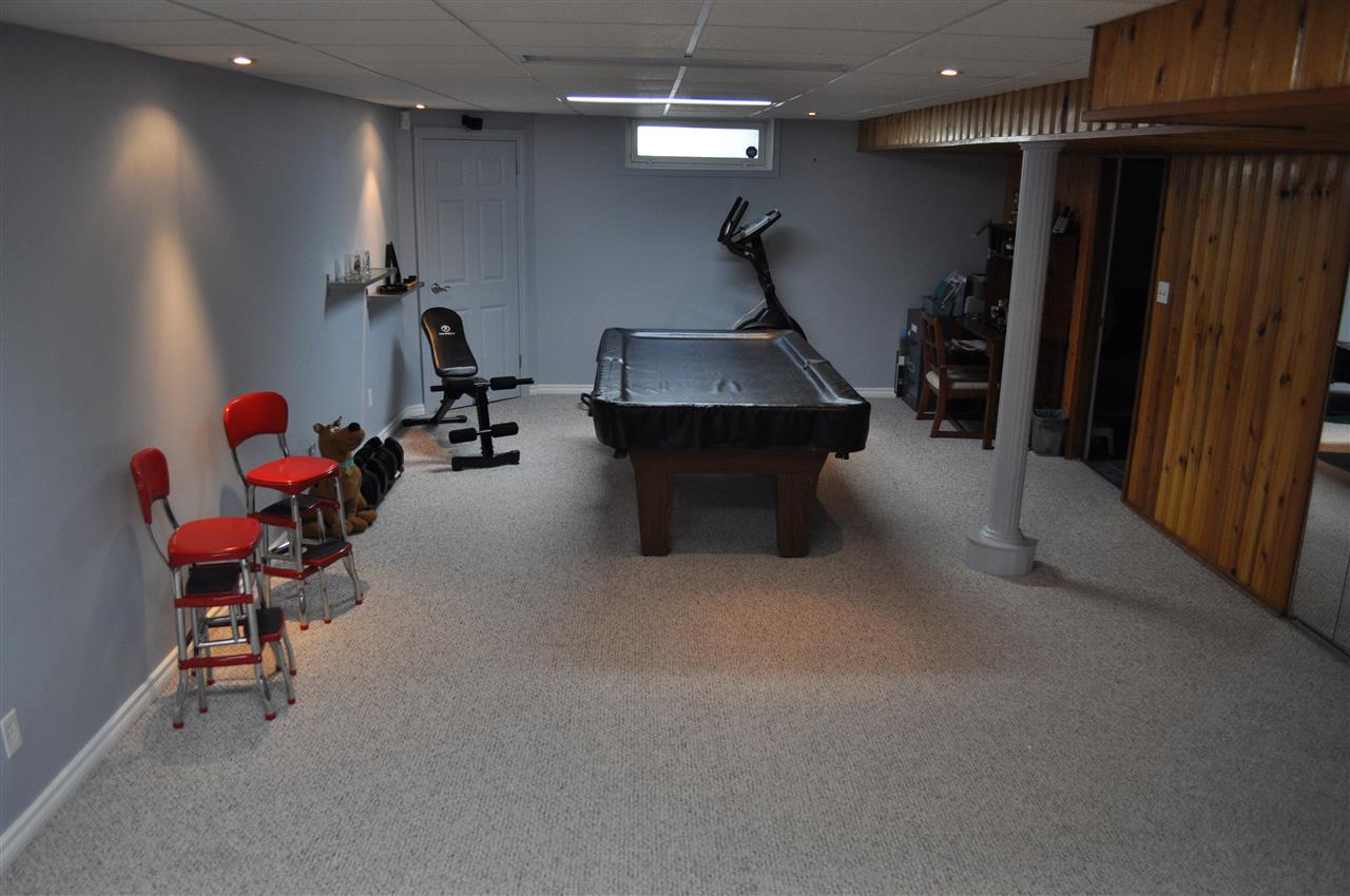 Again, at 1149 square feet, this house has elbow room, and clearly a pool table fits in the rec room, with room to spare.  The owner may even consider an option to include the slate table in the sale, if it interests you.  Come check it out