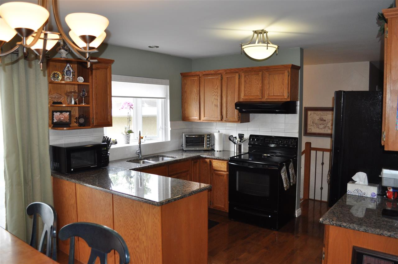 The oak kitchen has a modern flair, with black appliances, granite counter tops, and again, the warm toned hardwood flooring.  The house has a mature, polished feel, with great updates throughout.
