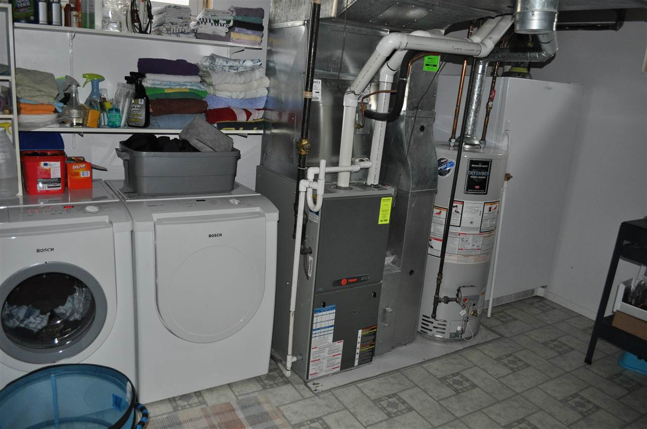 The utility room is large, and has room for an extra freezer, storage, the recent water tank and furnace, as well as the Bosch laundry pair.