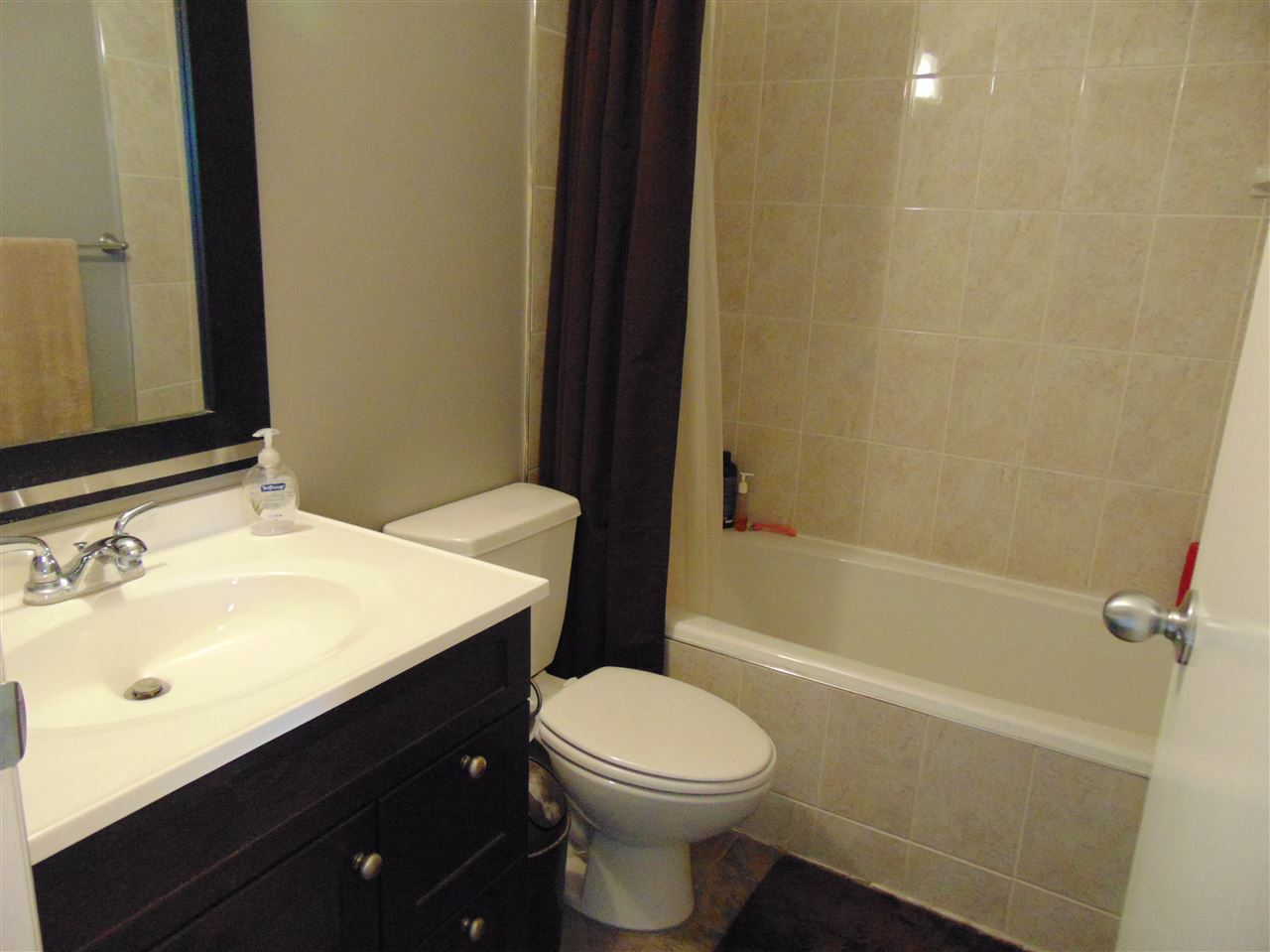 New ceramic tile flooring, vanity, toilet and mirrors
