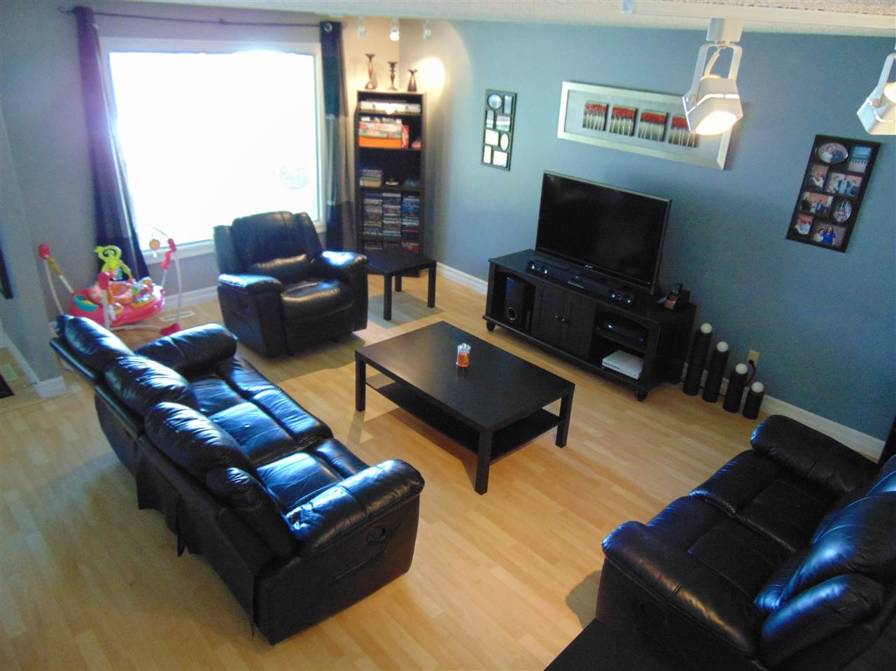 Nice size living room with new baseboards and trim.