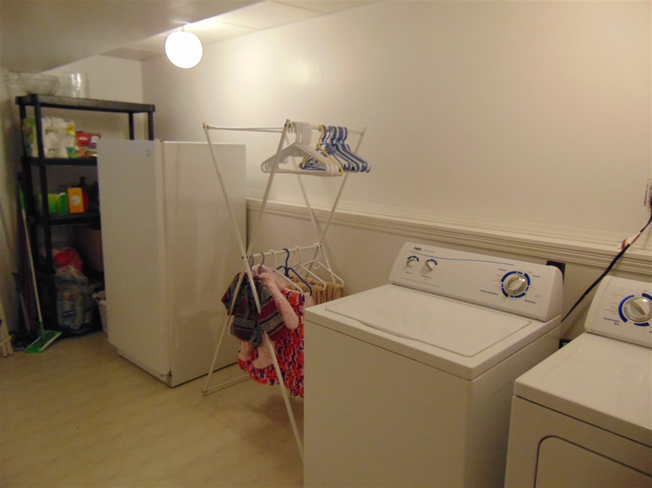 Awesome laundry room with lots of extra storage space!