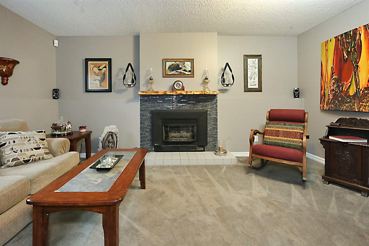Gas burning fireplace with new mantel and tile in family room...