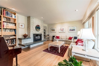 Gorgeous hardwood floors with inlay. Gas fireplace. Big, bright windows.