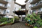 "Main Photo: 106 33480 GEORGE FERGUSON Way in Abbotsford: Central Abbotsford Condo for sale in ""Carmody Ridge"" : MLS® # R2214640"