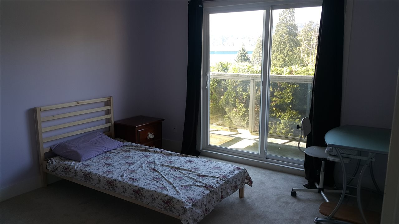 second bedroom with water views and balcony.