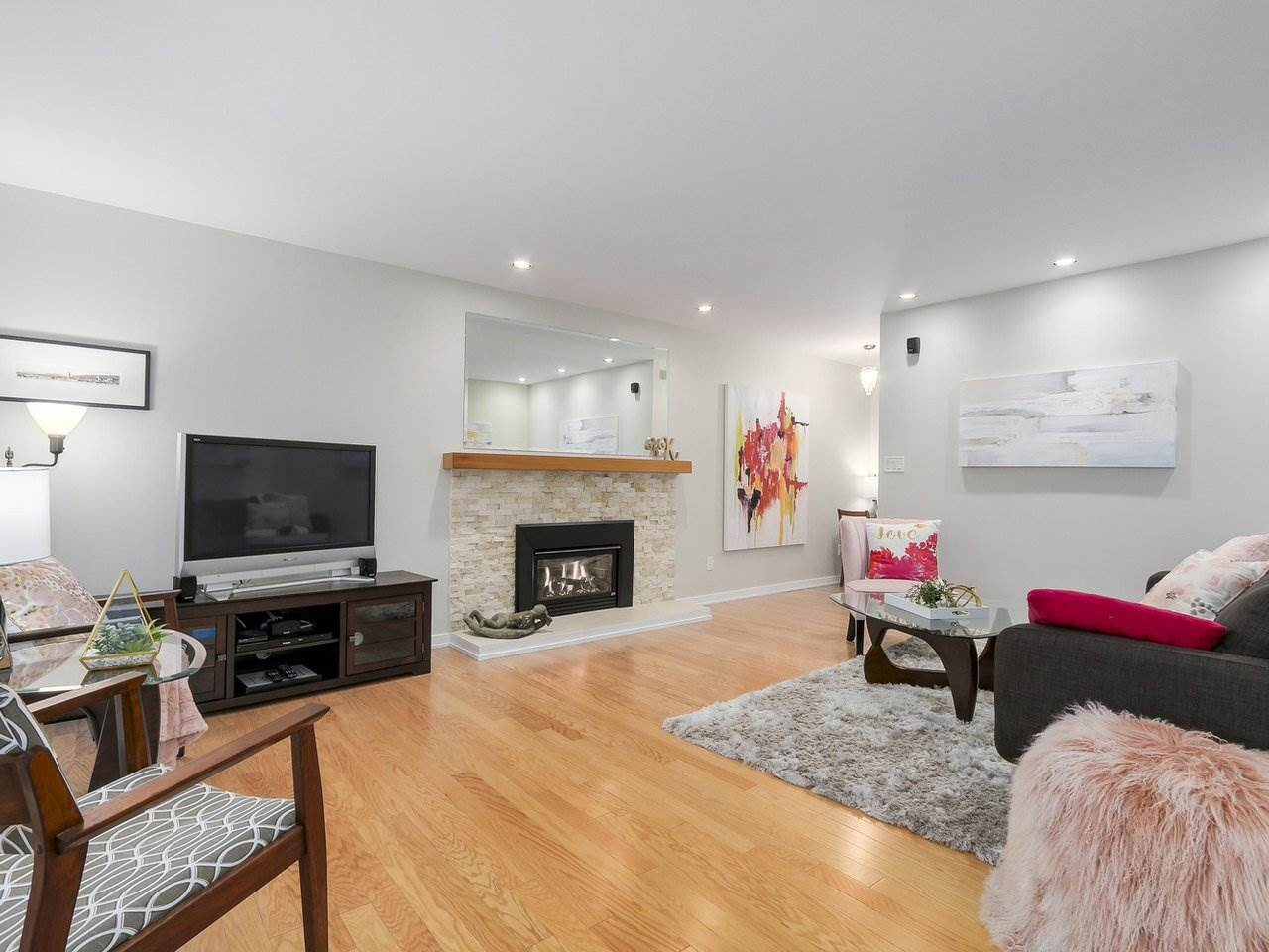 Living Room below is spacious and open with a new gas fireplace, hardwood floors
