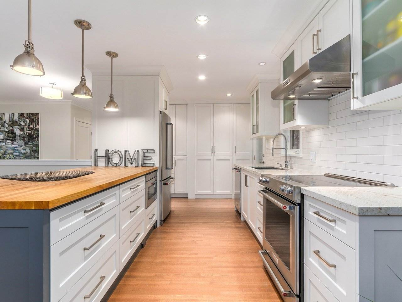Amazing renovations in the kitchen includes: Marble counters, Kitchen Aid Appliances, ample pantry space. Separate laundry for upstairs built in the kitchen area.