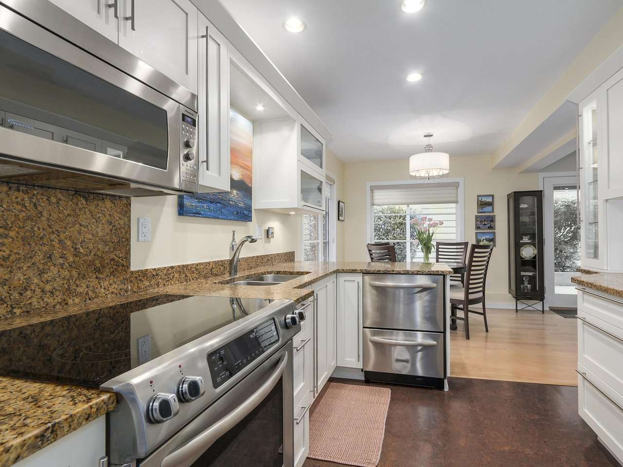 Downstairs Kitchen is also white shaker cabinets, stain less steel appliances, and granite counter tops. Downstairs offers its own separate full size laundry as well.
